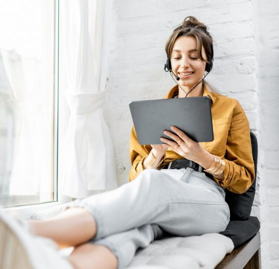 Woman working online on the window sill